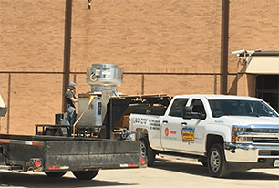 Commercial AC being unloaded